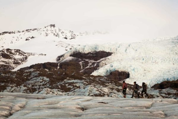 A group heads up towards the blue ice cave on their exclusive ice cave tour