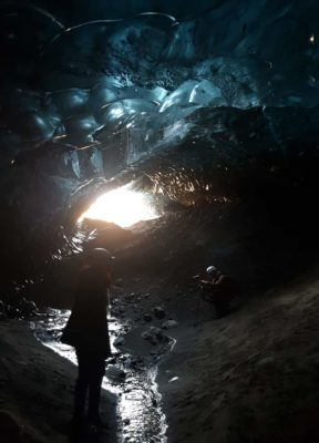 A man photographs a girl on the helicopter ice cave tour
