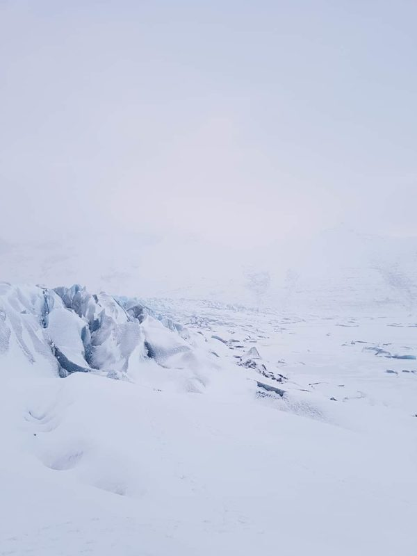 a lot of snow covering the blue ice on skaftafellsjökull glacier in skaftafell